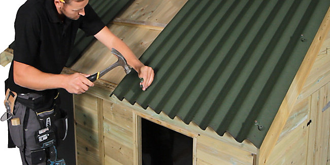 Fitting roofing sheets